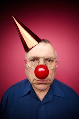 Portrait of unhappy man with a red nose and in a c...