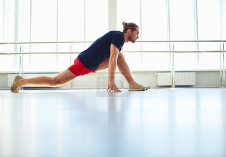 Man doing  exercise for stretching