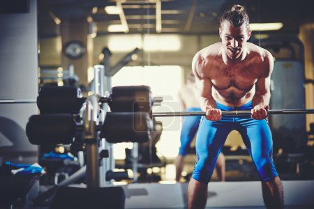 Photo for Portrait of sporty topless man with weight looking at camera - Royalty Free Image