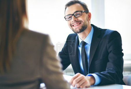 Businessman interviewing female