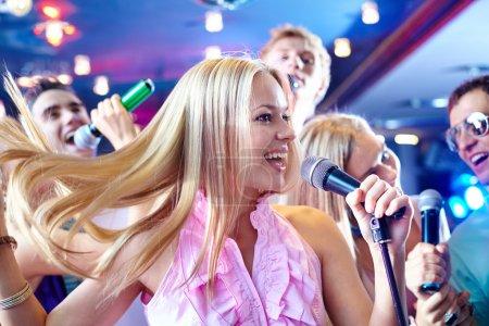 Girl singing at party