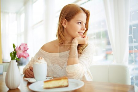 Girl sitting in cafe