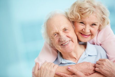 Happy and affectionate elderly couple