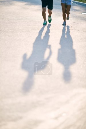 Shadows of runners