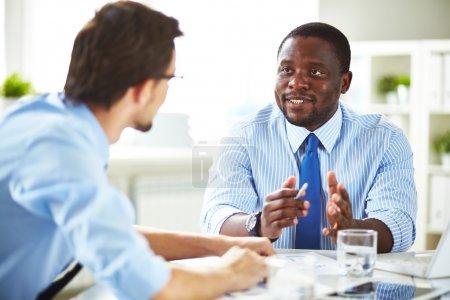 Businessmen interacting at meeting