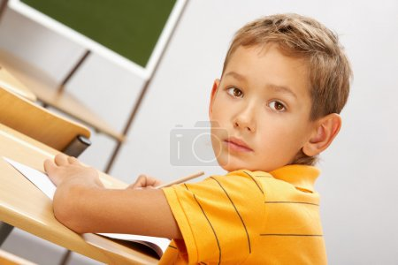 Boy at his place during lesson