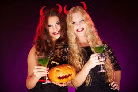 Females holding Halloween pumpkin