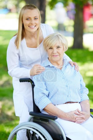 Nurse and senior patient in a wheelchair