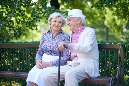 Photo for Happy seniors talking while sitting in the park - Royalty Free Image