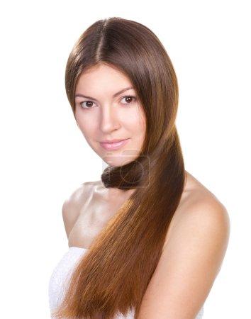 Photo pour Belle femme avec de longs cheveux brillants isolés sur fond blanc - image libre de droit