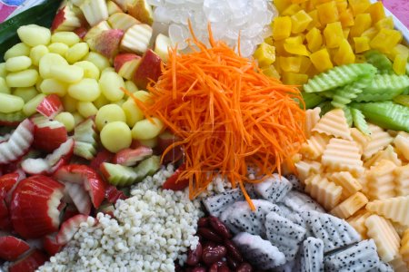 Salads, vegetables, fruit in a dish large pad with...