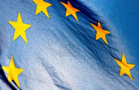 Photo for Fragment of the European Union Flag waving in in backlit sunlight - Royalty Free Image