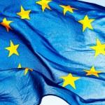 European union flag against the sky and sunlight...