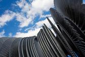 Steam turbine of nuclear power plant against sky