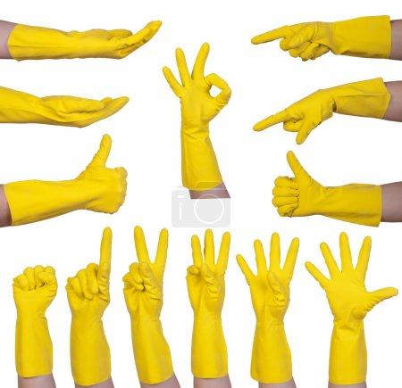 Hand gestures in yellow rubber glove