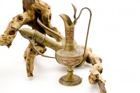 Photo for Old wine carafe with wooden root - Royalty Free Image