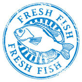 Grunge rubber stamp with fish shape and the word Fresh fish written inside