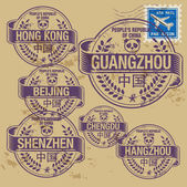 Grunge rubber stamp set with names of China cities