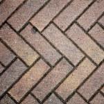 Brown granite block street pavers in patern....