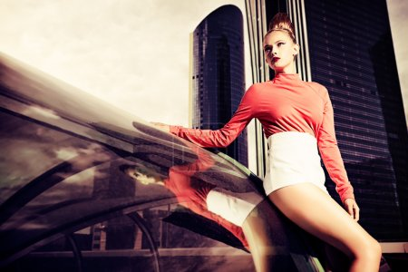 Photo for Vogue model posing over big city background. - Royalty Free Image