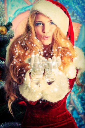 Photo for Beautiful young woman in Santa Claus clothes over Christmas background. - Royalty Free Image
