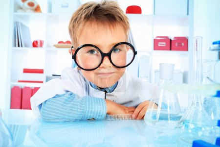Photo for Cute boy is making science experiments in a laboratory. Education. - Royalty Free Image