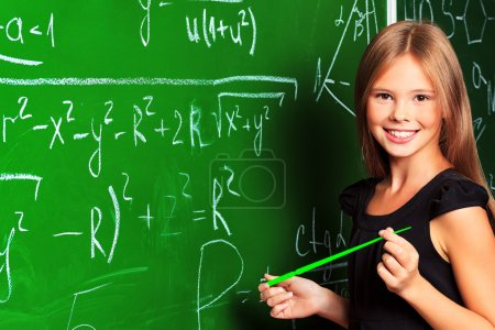 Photo for Portrait of a smiling schoolgirl in a classroom. - Royalty Free Image
