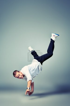 Photo for Young man dancing hip-hop at studio. - Royalty Free Image
