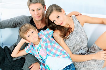 Photo for Portrait of a happy parents with their son together at home. - Royalty Free Image