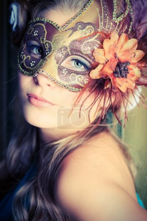 Photo for Portrait of a beautiful young woman in a carnival mask. Vintage style. - Royalty Free Image