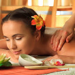 Beautiful young woman taking spa treatments at the...