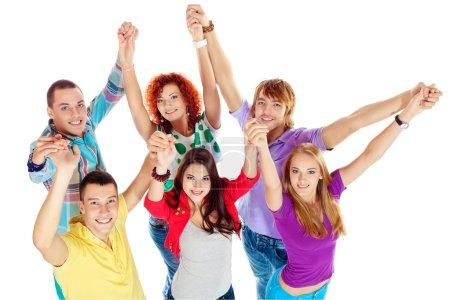 Photo pour Groupe de jeunes debout ensemble et tenant la main. L'amitié. Isolé sur blanc . - image libre de droit