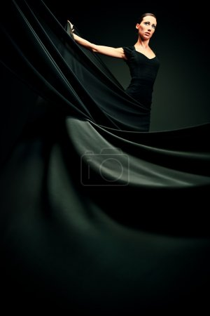 Photo for Art fashion photo of a beautiful woman in black dress. Over black background. - Royalty Free Image