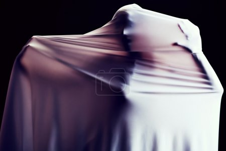 Photo for Art photo of a women silhouette breaking through the fabric. Struggle concept. - Royalty Free Image