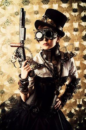 Photo pour Portrait d'une belle femme steampunk tenant un pistolet sur fond vintage . - image libre de droit