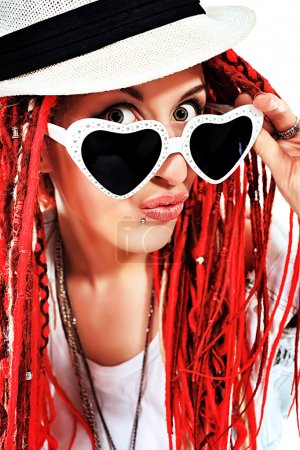 Photo for Expressive girl rock singer with great red dreadlocks. Isolated over white. - Royalty Free Image