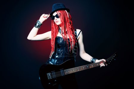 Photo for Modern girl rock musician is playing the electric guitar. - Royalty Free Image