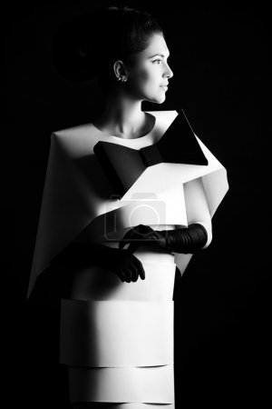 Photo for Art fashion photo of a gorgeous woman in paper dress. Black and white. - Royalty Free Image