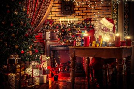 Photo for Santa Claus making Christmas gifts at home. - Royalty Free Image