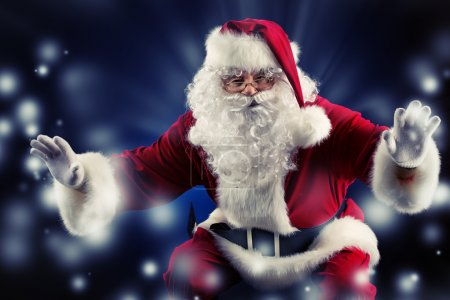 Photo for Traditional Santa Claus posing over dark background. Christmas. - Royalty Free Image