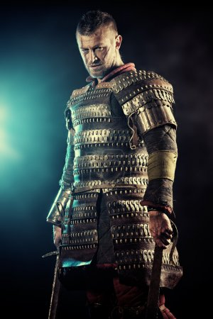 Photo for Portrait of a courageous ancient warrior in armor with sword. - Royalty Free Image