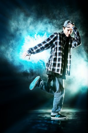 Photo for Modern young man dancer dancing at studio. - Royalty Free Image