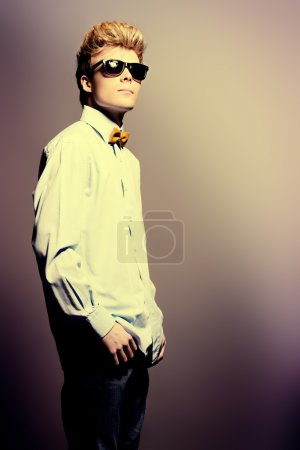 Photo for Portrait of a modern handsome young man in sunglasses. Studio shot. - Royalty Free Image