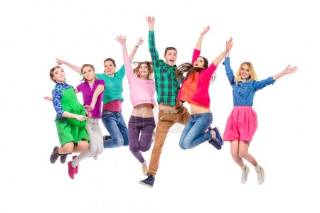 Photo for Large group of cheerful young people jumping for joy. Isolated over white. - Royalty Free Image
