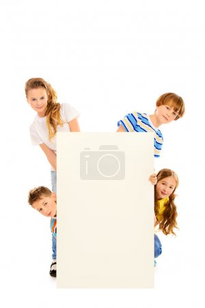 Photo for Funny girls and boys look out from the white billboard. Isolated over white. - Royalty Free Image