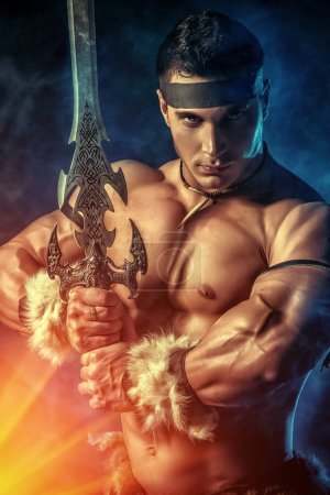 Photo for Portrait of a handsome muscular ancient warrior with a sword. - Royalty Free Image