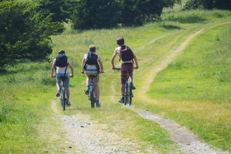 Cyclists cycling along south downs way