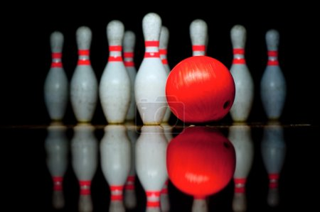 Ten bowling pins and ball