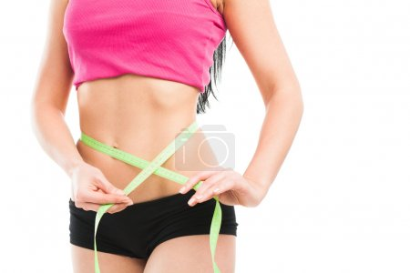 Photo for Woman measuring her waistline, isolated on white - Royalty Free Image