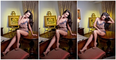 Attractive woman in lingerie posing challenging on a table. Portrait of woman with long legs and high heels. Sensual woman sitting on the table posing provocatively looking directly into the camera